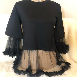 Reveuse Knit top with sheer ruffled accents